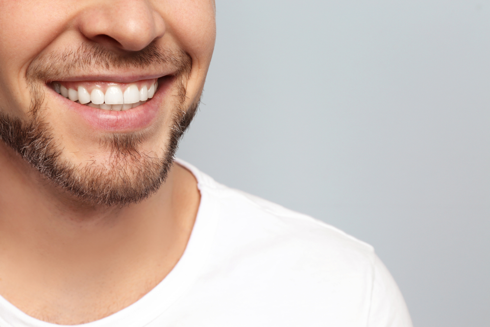 a bearded man smiling